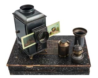 Boxed magic lantern, accessories and slides. Image © The Bill Douglas Cinema Museum